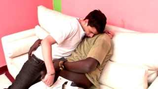 Amazing brunette gay Naza giving handjob to Canu's impossible black penis on the couch