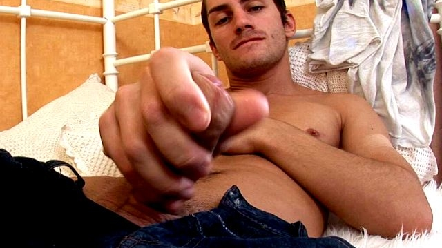 amazing-brunette-gay-tommy-showing-off-his-massive-pecker-in-the-bedroom_01