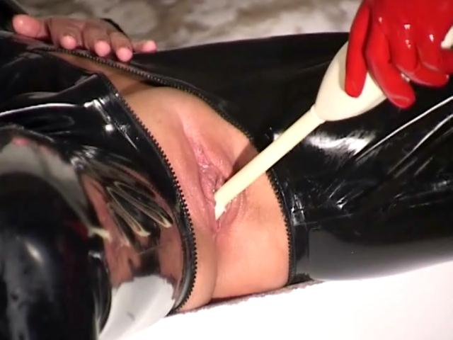 Amazing mistress in red latex stockings and gloves have fun with slaves pussies