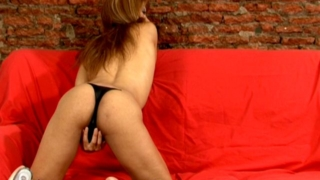Amazing tranny hoe in high heels Morena showing off her booty and big tits on the couch