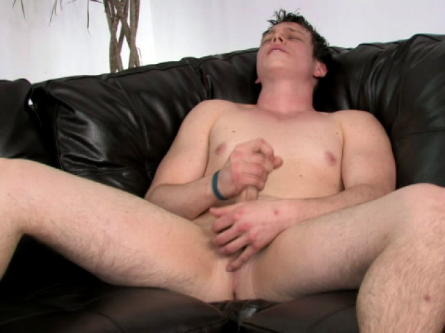 Amazingly brunette gay Bruce masturbating his huge dick on the couch