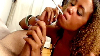 Amazingly curly haired smoker whore Autumn Foxxe sucking a big dick on her knees