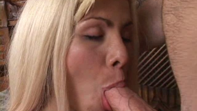 appealing-blonde-tranny-bitch-sucking-a-massive-penis-on-her-knees_01