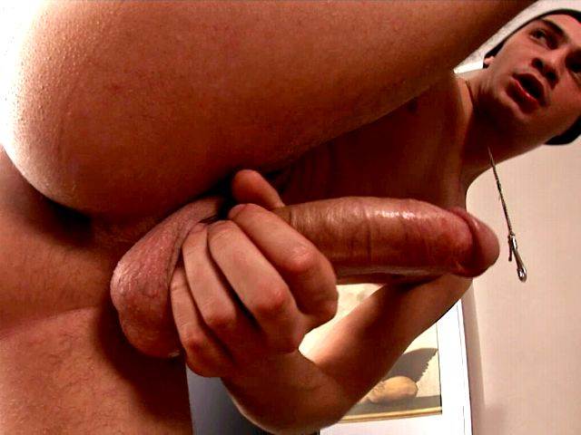 Appealing brunette gay Timo Hardy masturbating his gigantic penis in close-up