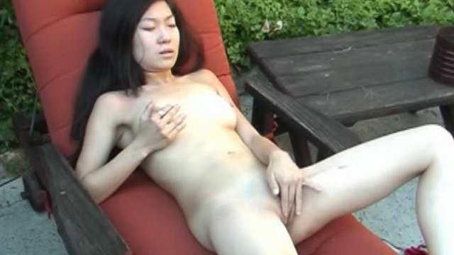 Asian-amateur-hottie-leandra-lee-stripping-red-undies-and-rubbing-trimmed-pussy-outdoors_01