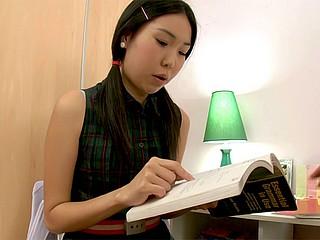 Asian babe doing her homework
