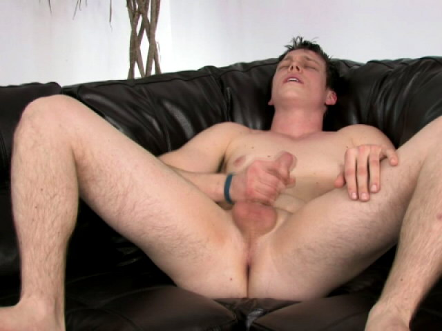 Athletic brunette gay Bruce masturbating his big schlong on the couch
