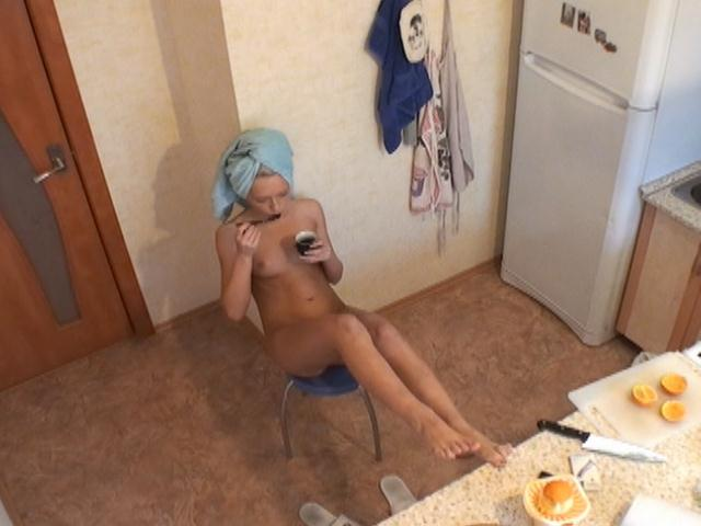 Attractive blonde voyeur hottie Alicia taking breakfast naked in the kitchen