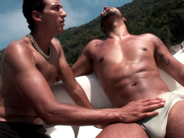 Awesome bronzed twinks Alan And Matheus touching their large cocks on a boat