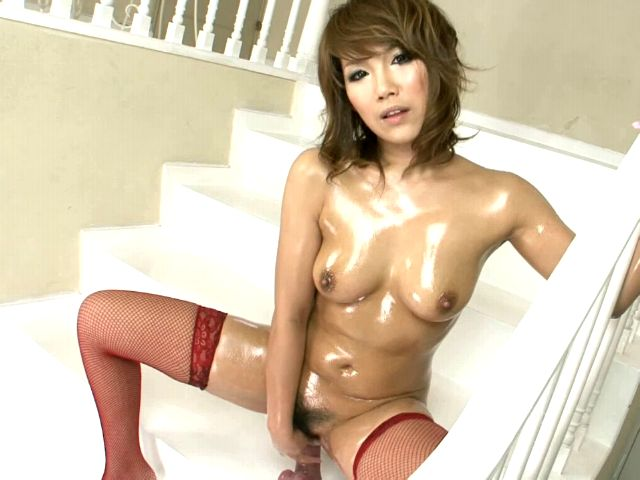 Awesome Japan nymphet Akiho Nishimura toying her hairy oiled pussy on the stairs