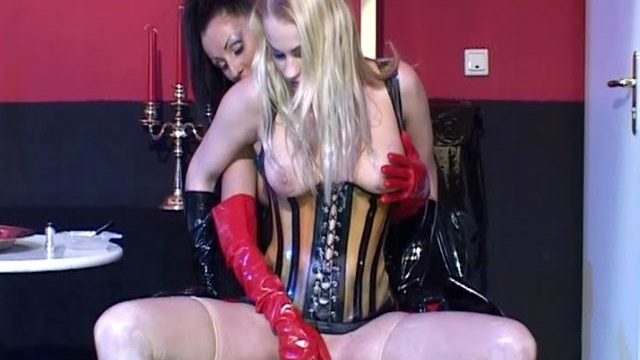 awesome-lesbians-in-rubber-fingering-their-slick-quims_01