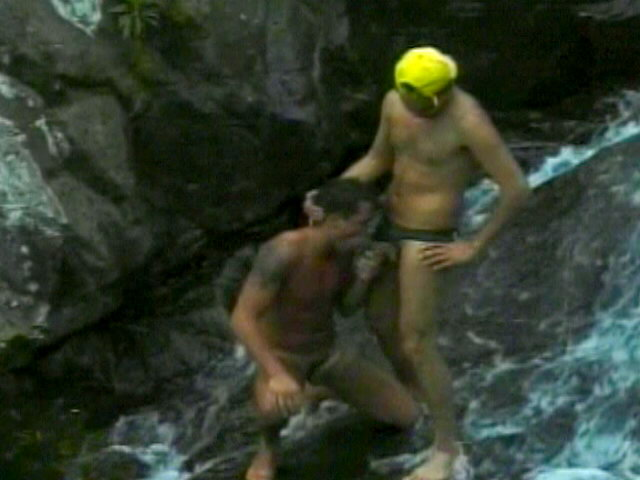 Awesome twinks Cristiano And Eduardo slurping their giant schlongs in the waterfall
