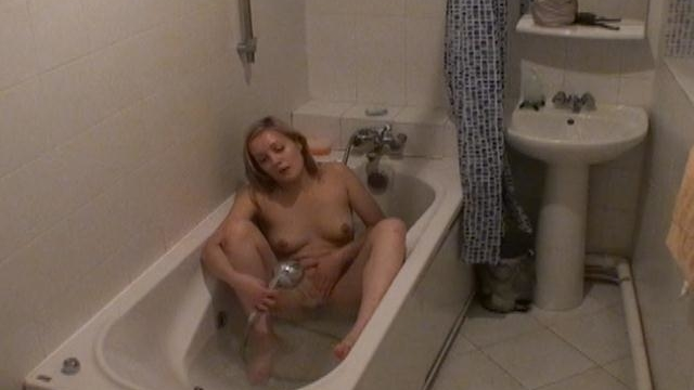 Bathroom-hidden-camera-filming-gorgeous-blonde-cutie-marina-masturbating-her-wet-beaver_01-1