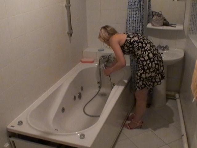 Bathroom hidden camera filming the hot blonde Marina getting ready for an erotic bath
