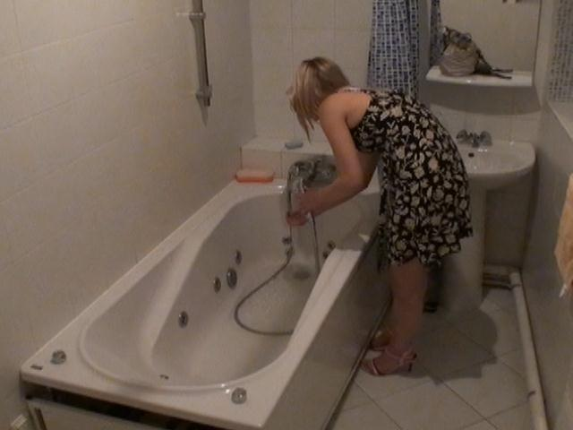 Bathroom hidden camera filming the hot blonde Marina getting ready for an erotic bath