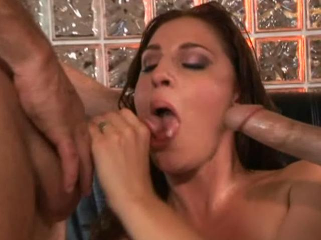 Beautiful brunette harlot Lauren Phoenix sucking a large cock in a threesome