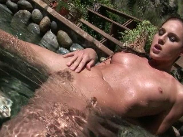 Beautiful brunette pornstar Lauren Phoenix masturbating pussy in the pool for a black stud