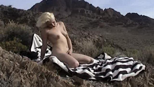 Beauty-blonde-amateur-stunner-masturbating-slick-pussy-outdoors_01-1