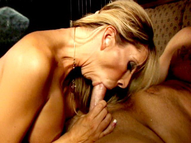 Beauty blonde smoker seductress Morgan Ray jerking off and sucking a massive penis