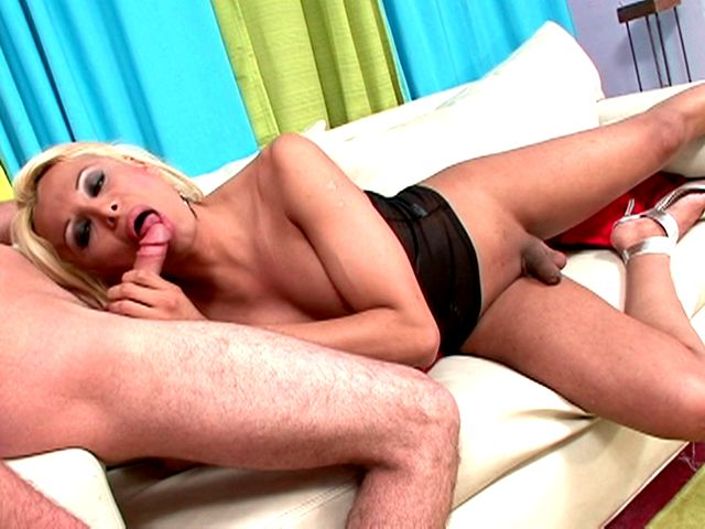 Bewitching blonde shemale goddess Sheyna sucking a large shaft on the camera