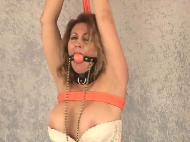 Big breasted slave in sexy white corset Autumn gets tied up and gagged