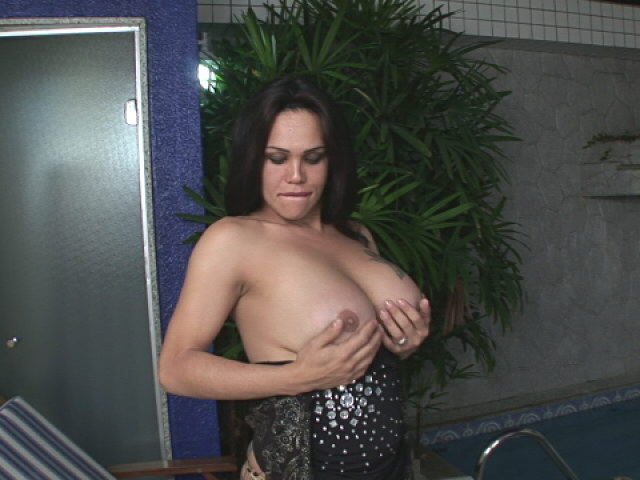 Big jugged brunette shemale Penelope Jolie showing her tattooed arse