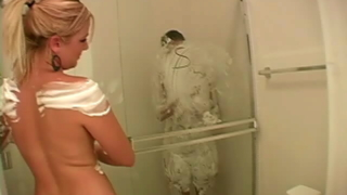 Big meloned blonde Jessie taking a shower with her lesbian friend