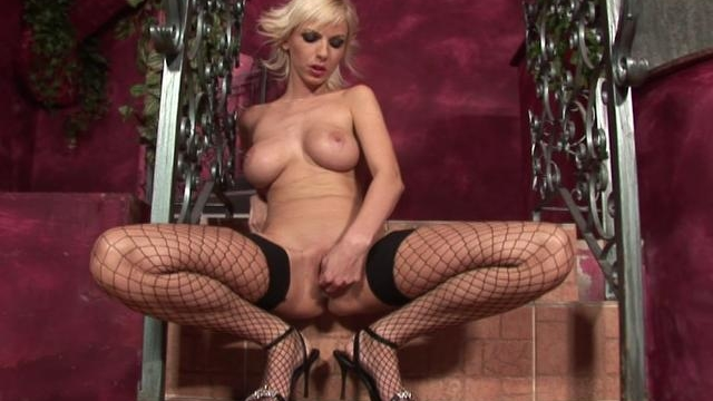 big-meloned-blonde-wench-in-fishnets-fingering-her-slit-on-the-stairs_01