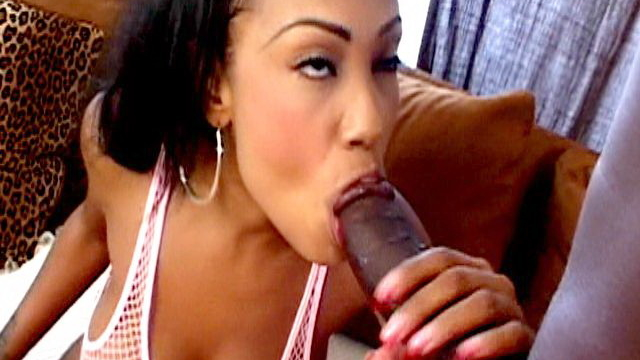 big-meloned-ebony-charmer-lacey-duvalle-smoking-and-sucking-a-monster-black-dick-on-the-couch_01
