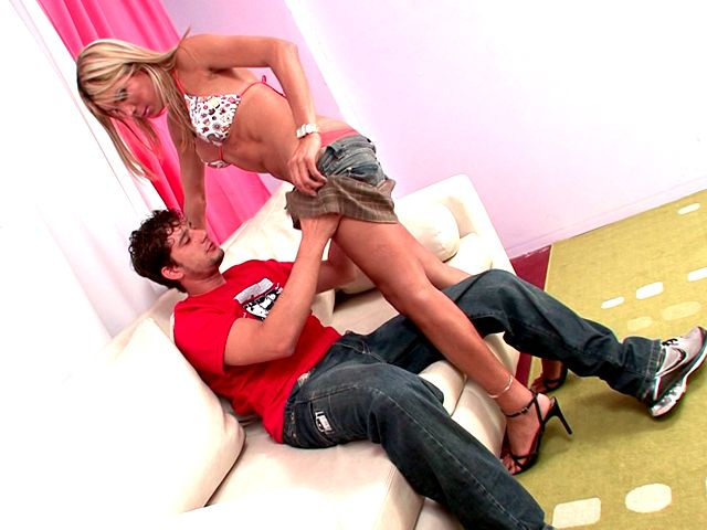 Blond shemale in high heels and mini skirt Melane teasing a dude with her hot assets