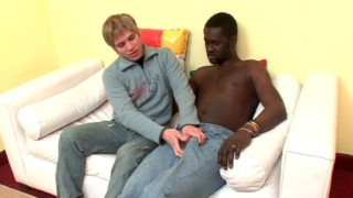 Blonde amateur gay Cristian gives blowjob and gets butt fucked by black Canu on the couch