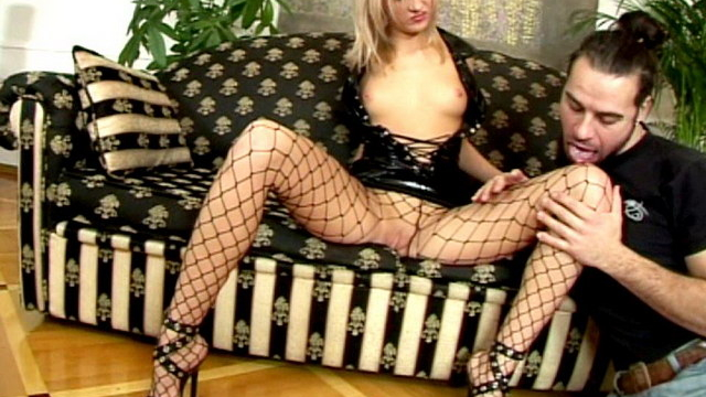 blonde-russian-temptress-in-latex-dress-and-fishnets-belinda-gets-wet-beaver-licked-on-the-couch_01