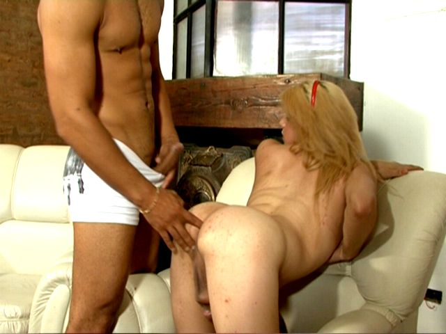 Blonde tranny whore Celeste slurping a massive penis on armchair