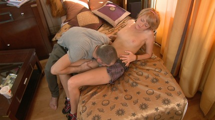 Bogdana pets her cunt and licks the balls of her stud.