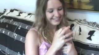 Brown haired cute teen Kitty Kim plays with a fake vagina in the bedroom