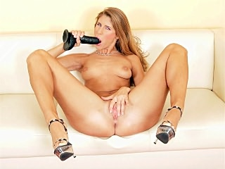 Brunette Masturbates With a Dildo