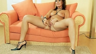 Brunette Masturbating with a Dildo