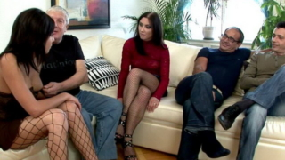 Brunette Russian whores Ravenna And Beatrice sucking two giant cocks in a foursome