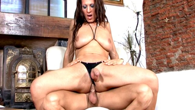 brunette-tranny-girl-with-huge-tits-triany-riding-anally-a-massive-cock-on-armchair_01