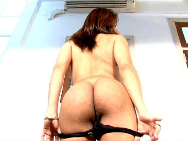 Brunette tranny with big tits Selia sucking a hard penis on the knees