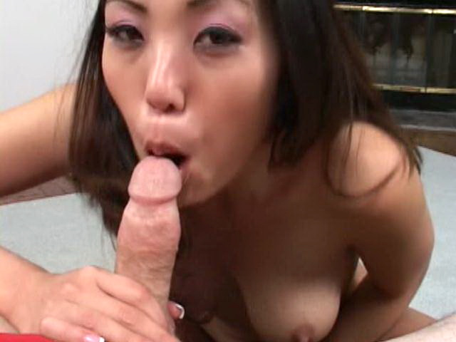 Busty asian nympho sucking a massive phallus in POV style