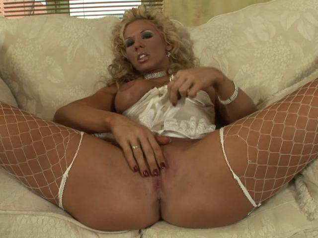 Busty blonde Czech honey in fishnets rubbing her wet twat