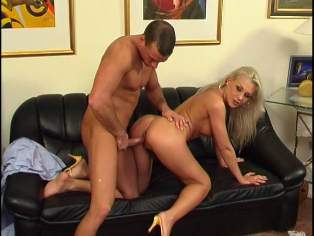 Busty blonde goddess gets screwed doggy style on the couch