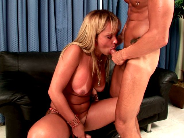 Busty blonde shemale in boots Dayanne wanking cock white giving oral sex on the couch Shemale Lolipops XXX Porn Tube Video Image