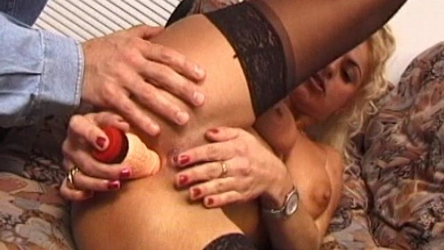 Busty-blonde-wife-in-stockings-dildoing-her-wet-snatch-on-the-couch_01