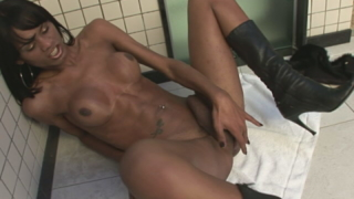Busty ebony shemale Kawana masturbating her hard dick on the bathroom floor