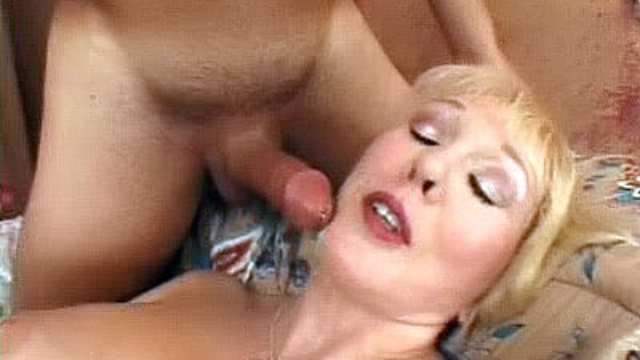 Busty-mature-milks-a-fat-cock_01