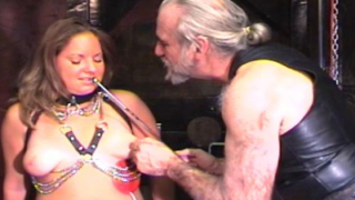 Chained slut cums