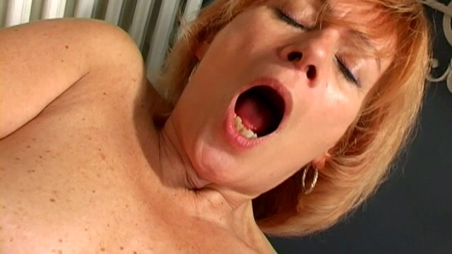 charming-granny-lady-spreads-pussy-and-fucks-a-giant-white-dildo_01