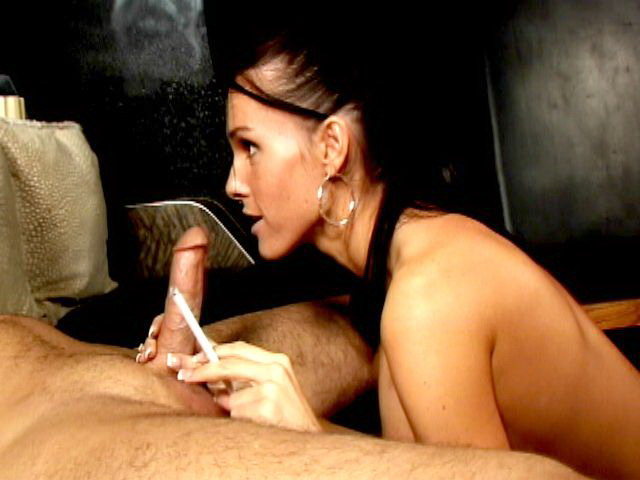 Chesty brunette smoker hooker Jennifer Dark sucking a massive cock on the camera